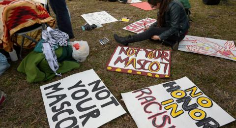 Leah Muskin-Pierret of Washington DC works on signs as part of a Native Americans protest against the Redskins team name before the Washington Redskins play the Arizona Cardinals in Landover MD on December 17, 2017 . (Photo by John McDonnell/The Washingto