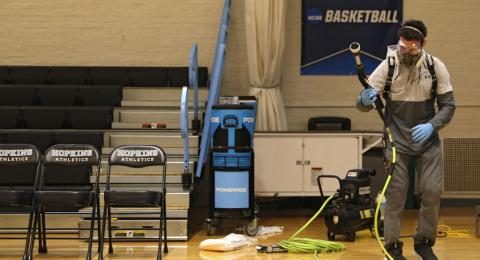 Taylor Michel, Director of Operations of DTG, Disinfecting Technologies Group, prepares to disinfect the arena following Yeshiva playing Worcester Polytechnic Institute in the NCAA Division III Men's Basketball Championship - First Round at Goldfarb Gymna
