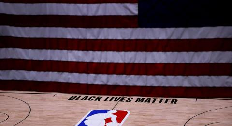 LAKE BUENA VISTA, FLORIDA - AUGUST 27: The Black Lives Matter logo is seen on an empty court as all NBA playoff games were postponed today during the 2020 NBA Playoffs at The Field House at ESPN Wide World Of Sports Complex on August 27, 2020 in Lake Buen