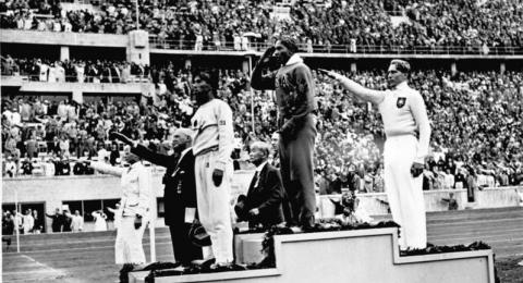 Jesse Owens winning first place at the 1936 Olympics.