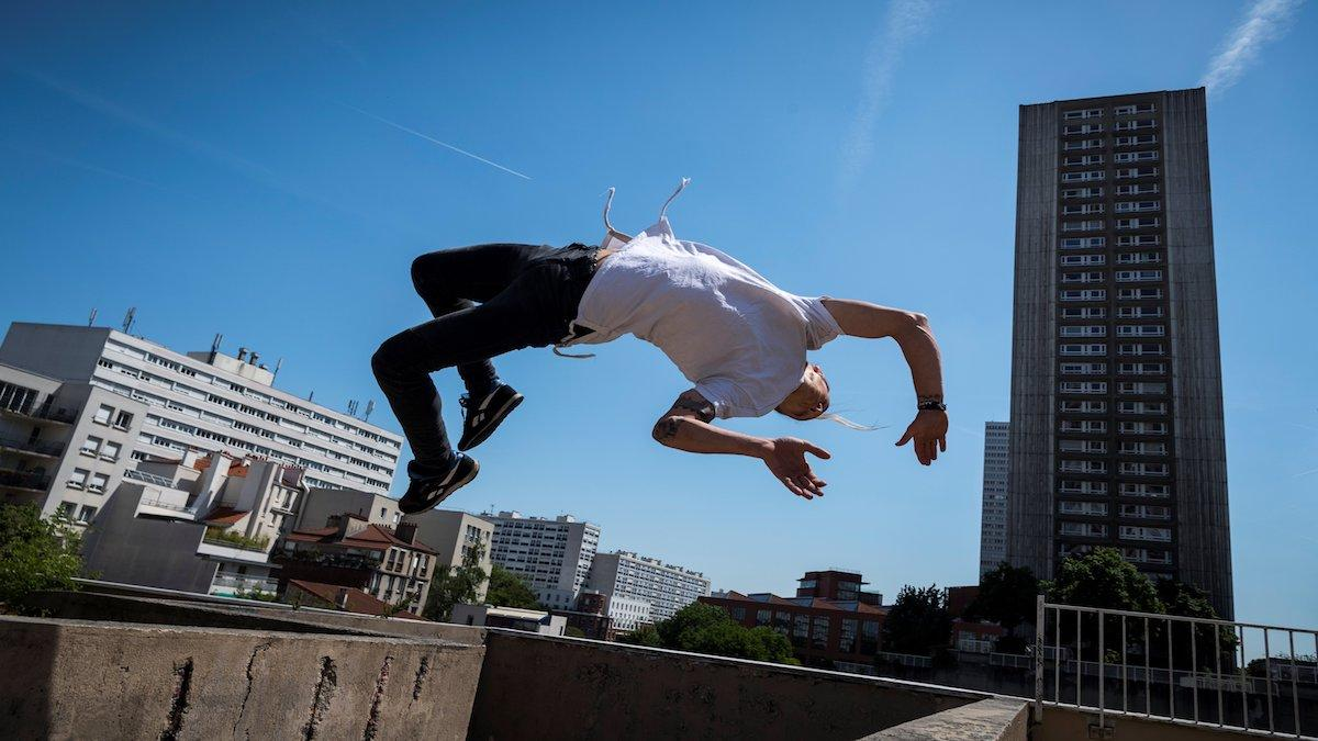 "PARIS, FRANCE - MAY 17: Johan Tonnoir, practices Parkour, an obstacle course method derived from military training ""parcours du combattant"" (obstacle course), on May 17, 2018 in Paris. (Photo by Phillippe Lopez / AFP)"