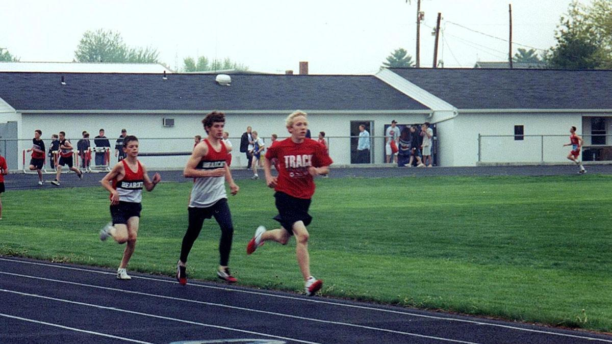 Luke Brenneman (left) competing in track.