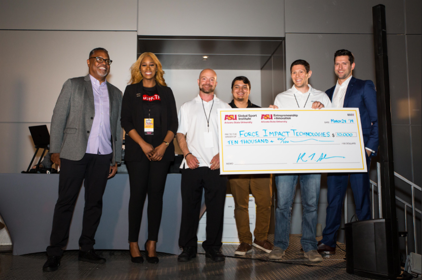 Venture Devil winners onstage receiving giant check with GSI