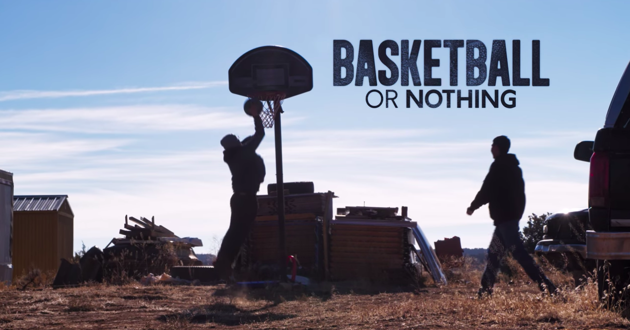 two people playing basketball on Navajo Nation