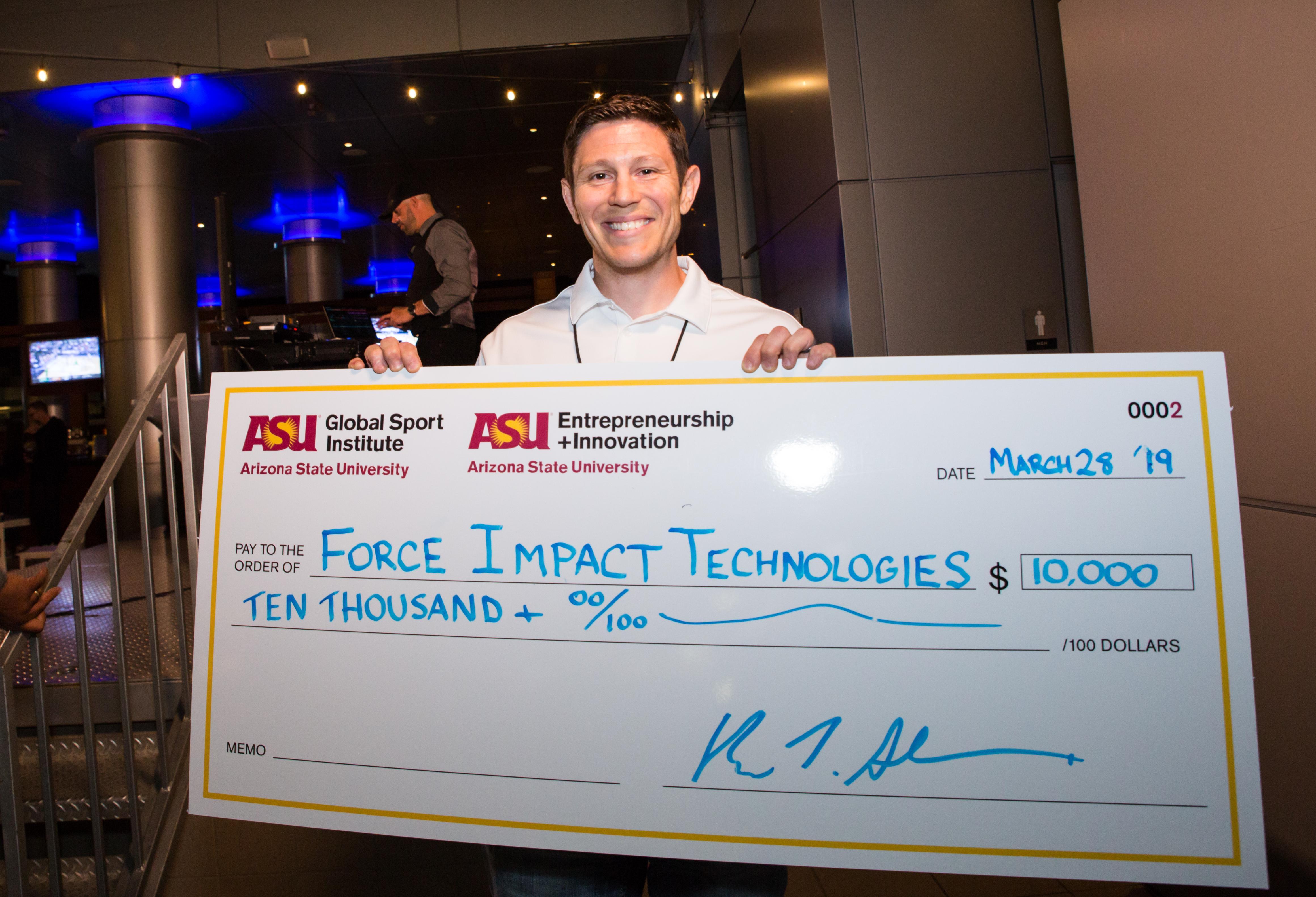 Venture Devil Program: Recipient receiving a check for $10,000.